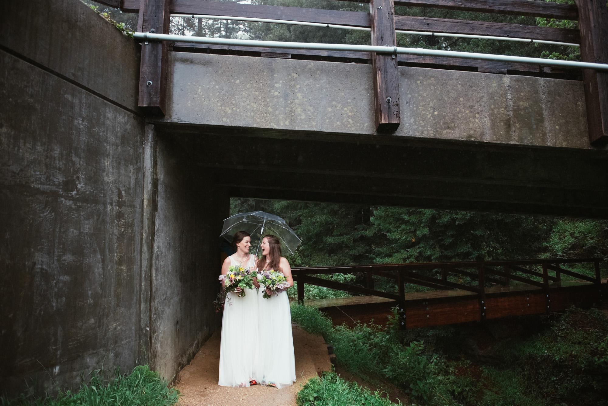 LGBTQ elope two brides laughing