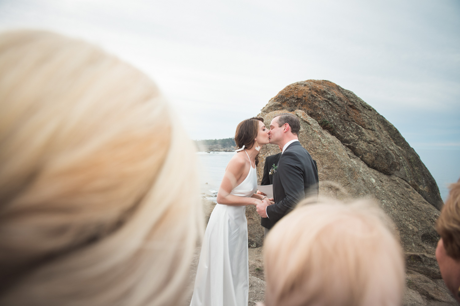 bride and groom kissing at minimony