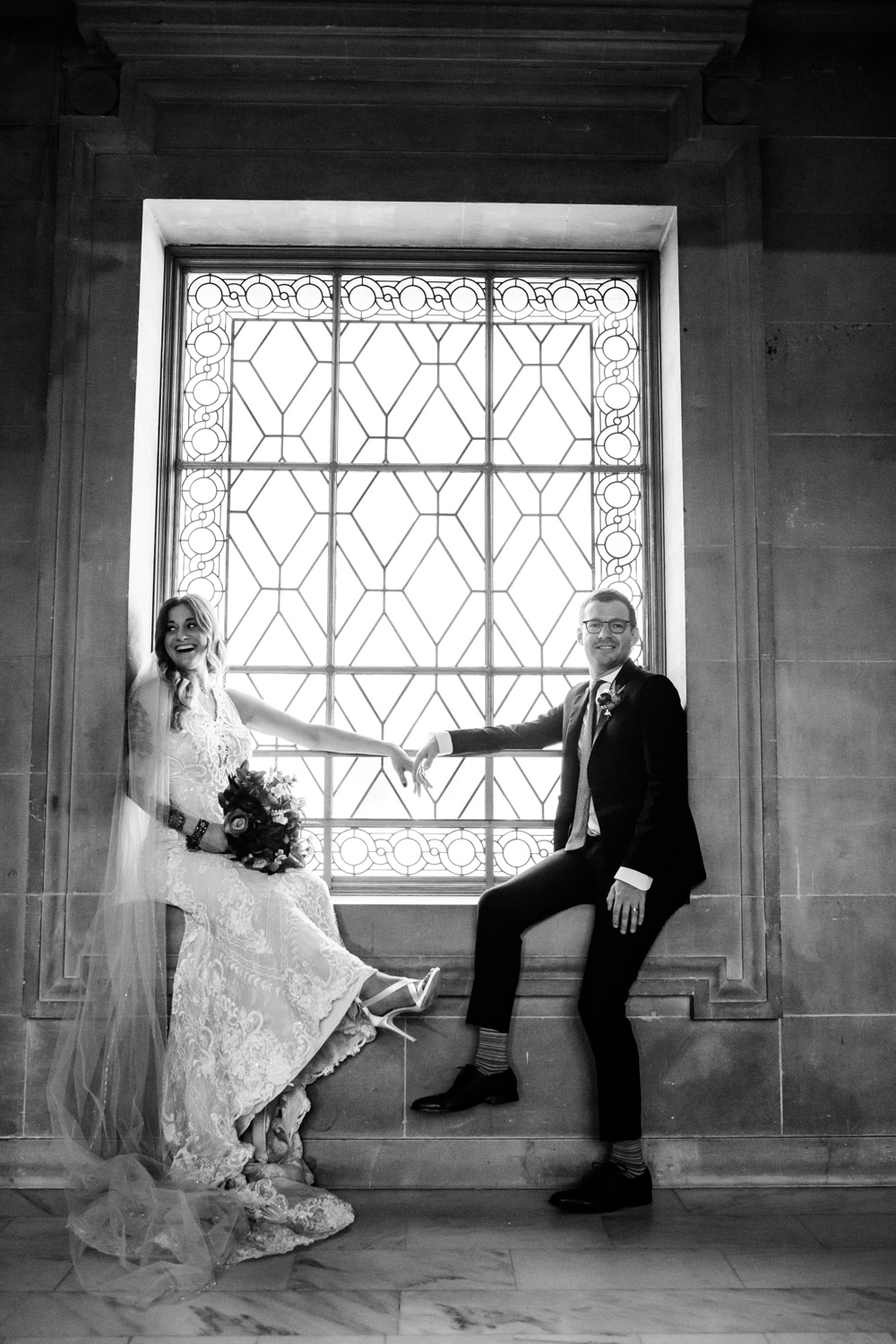 bride and groom in city hall